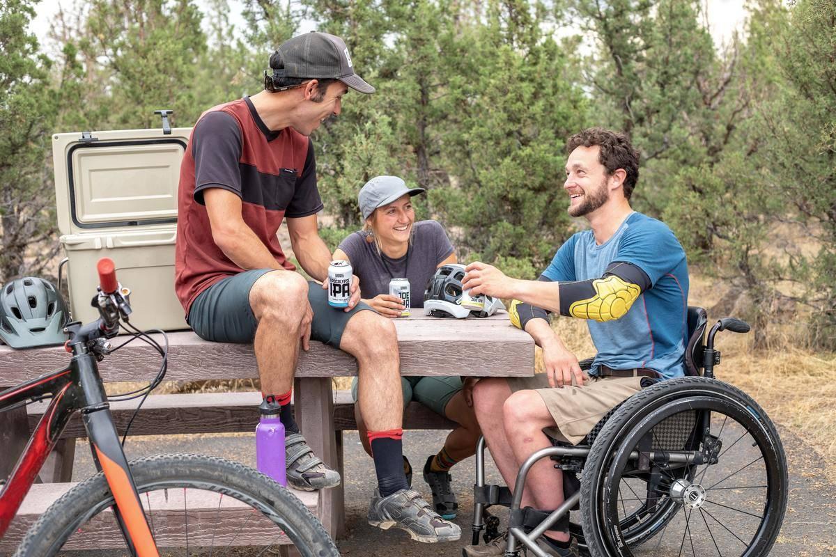 men talking around picnic table