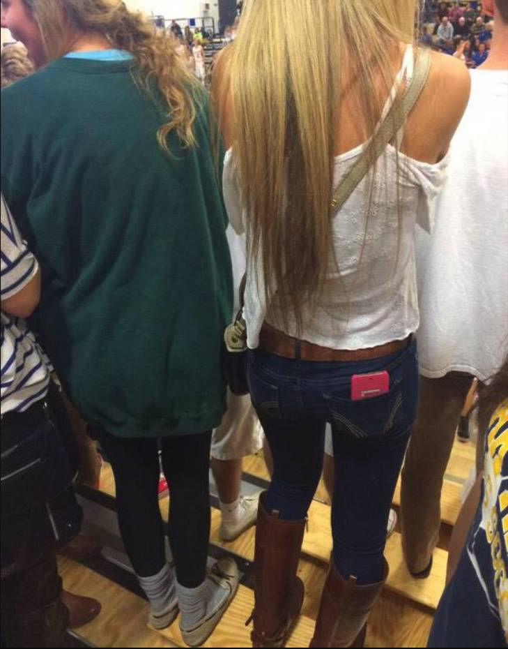 two girls wearing totally opposite outfits