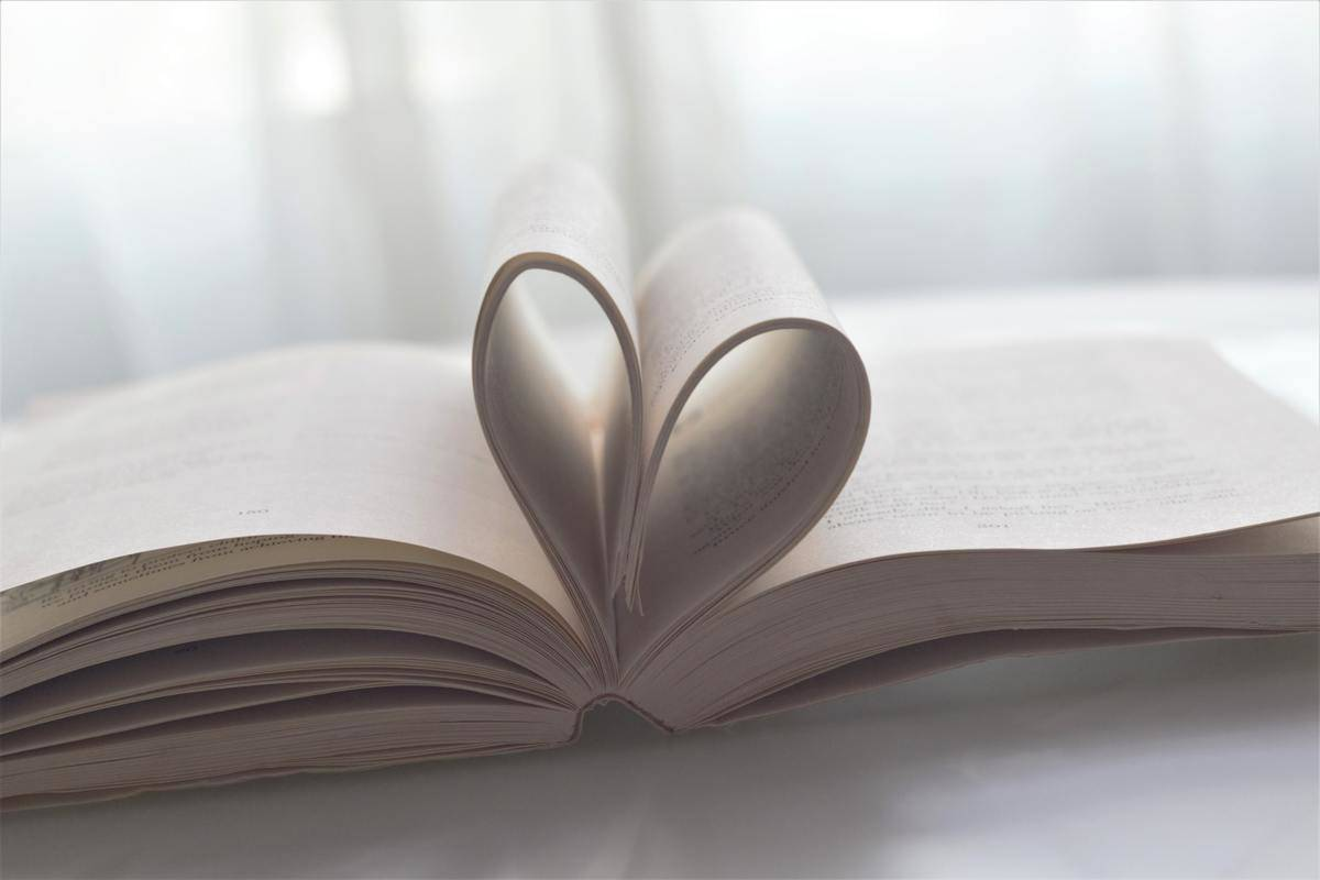 pages of book folded to look like heart