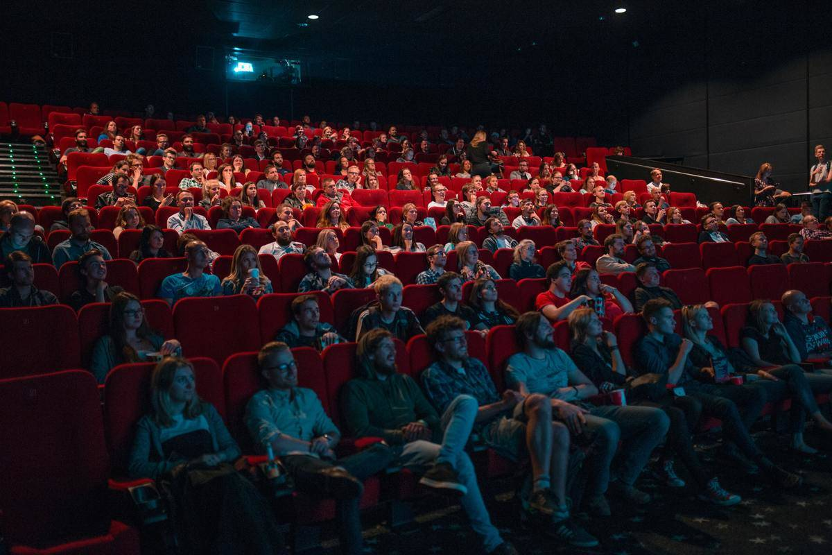 shot of inside movie theater people staring at screen