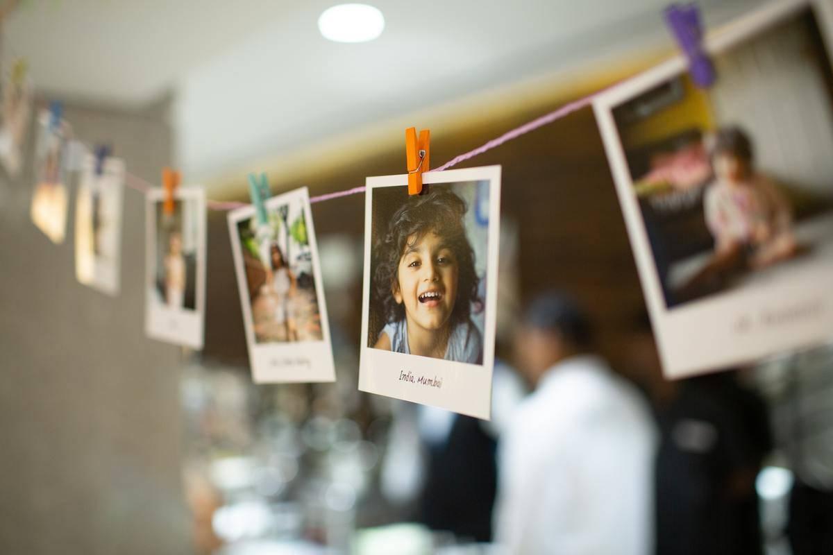 photos of kids displayed on string