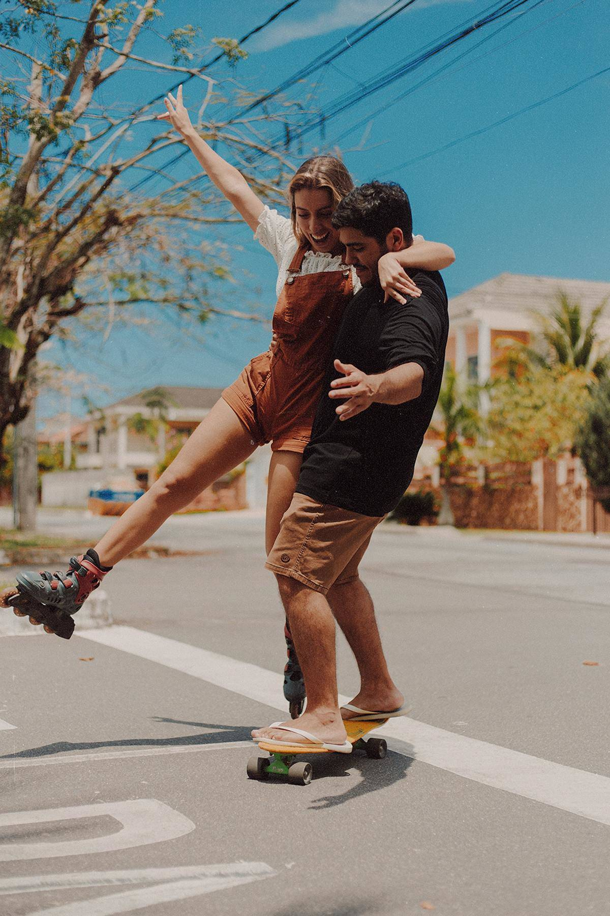 a couple skateboarding together