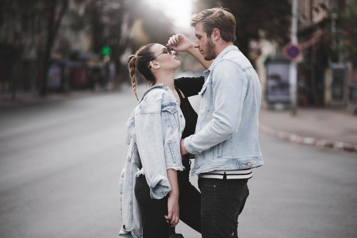 couple standing on a street together