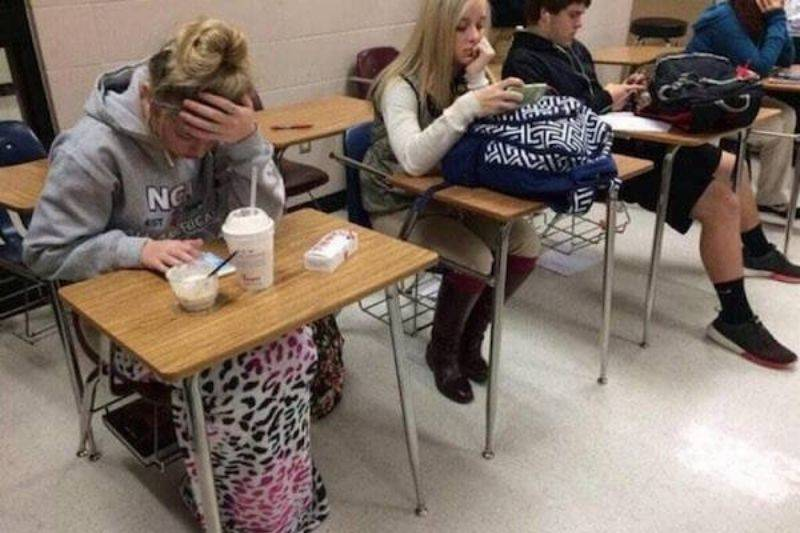 two girls dressed up for school, one of them in sweat pants, the other in a nice outfit