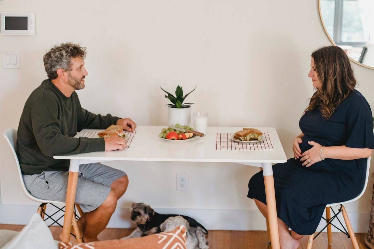 couple sitting across from each other at table
