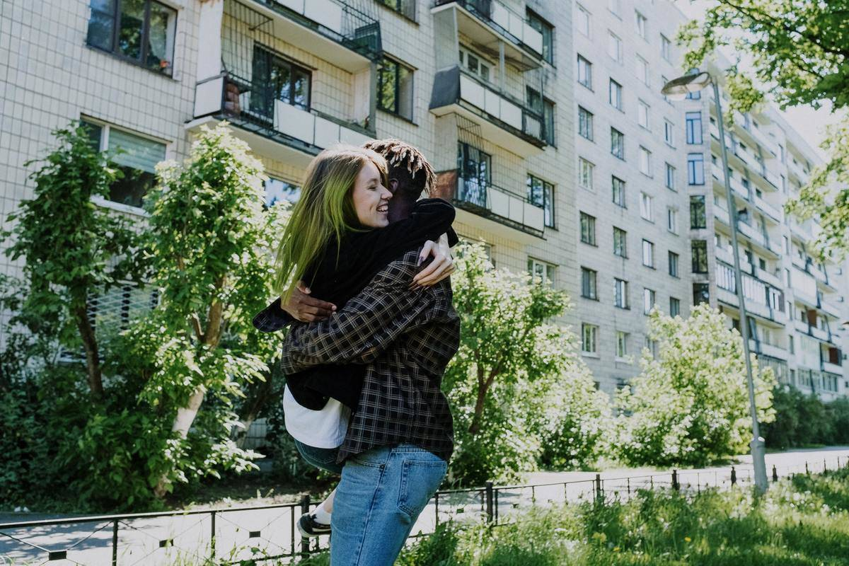 two people hugging happy
