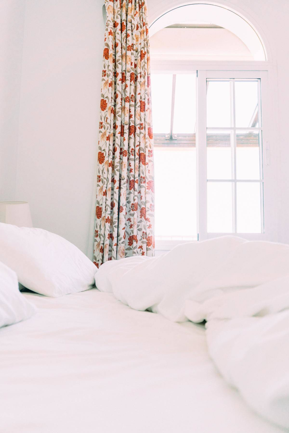 a white room with flower curtains