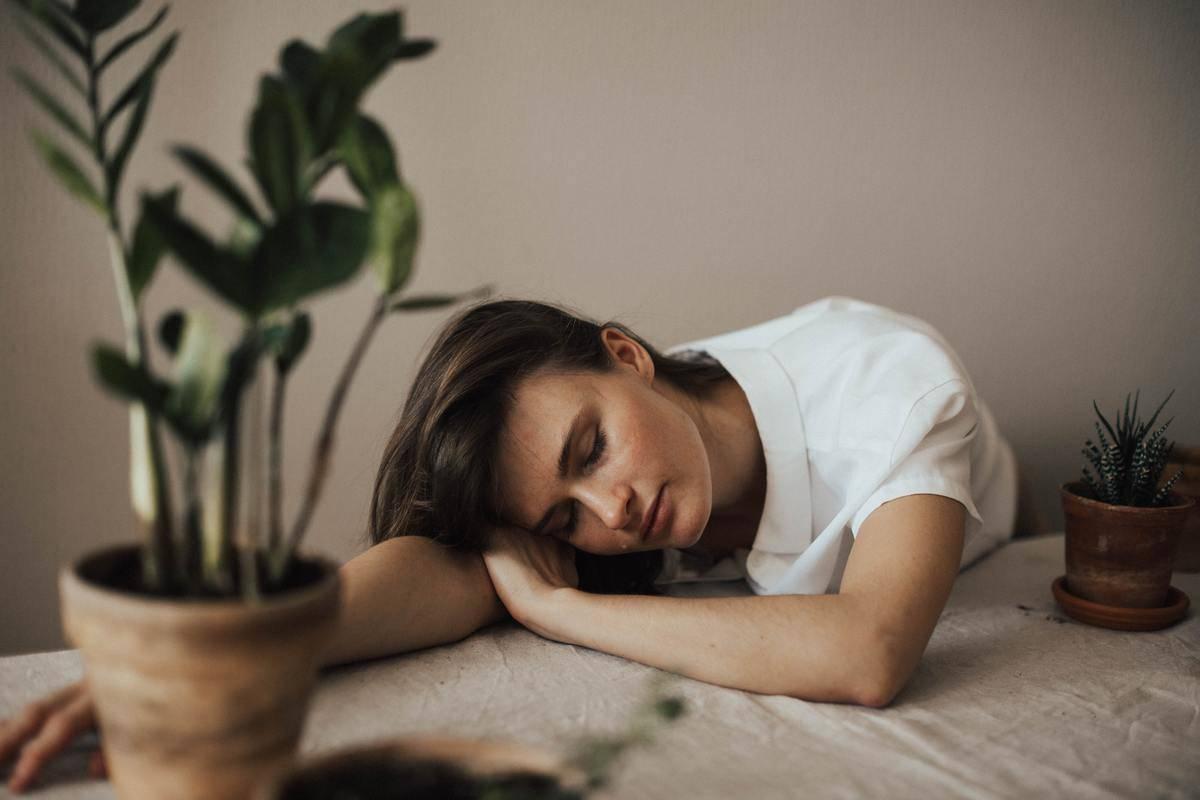 woman sleeps on her on table