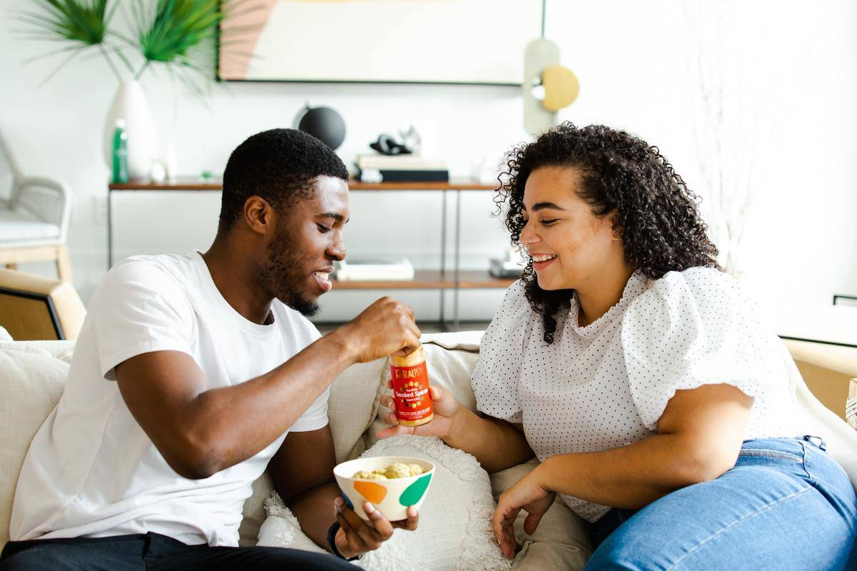 woman presenting man with treat