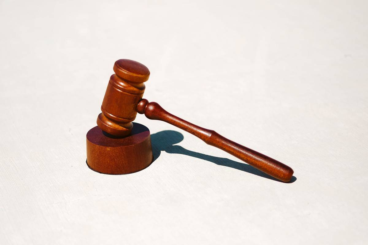 a judge's gavel on a white background