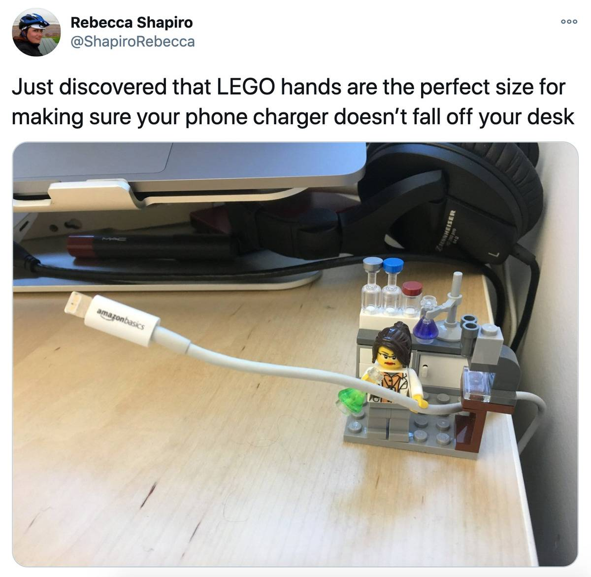 Tweet: Just discovered that LEGO hands are the perfect size for making sure your phone charger doesn't fall off your desk