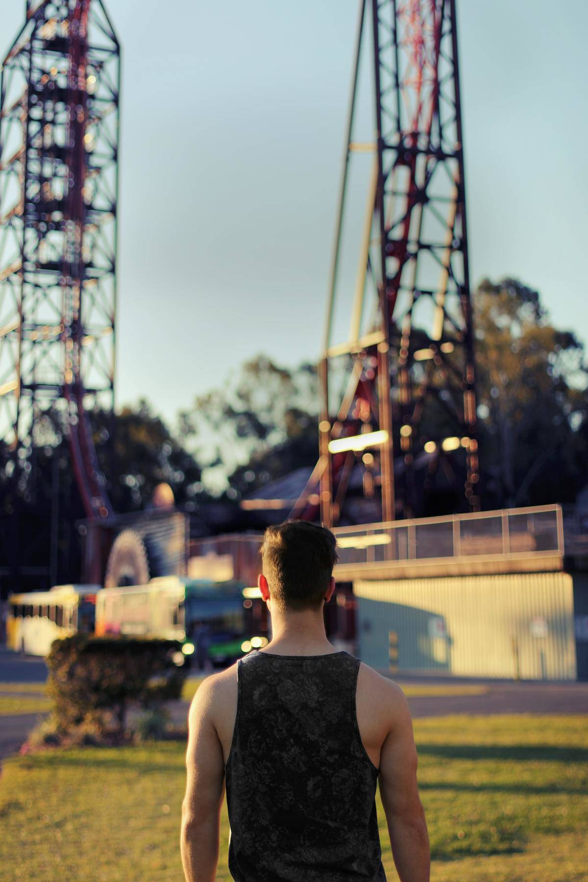 Man in front of rollercoaster looking up