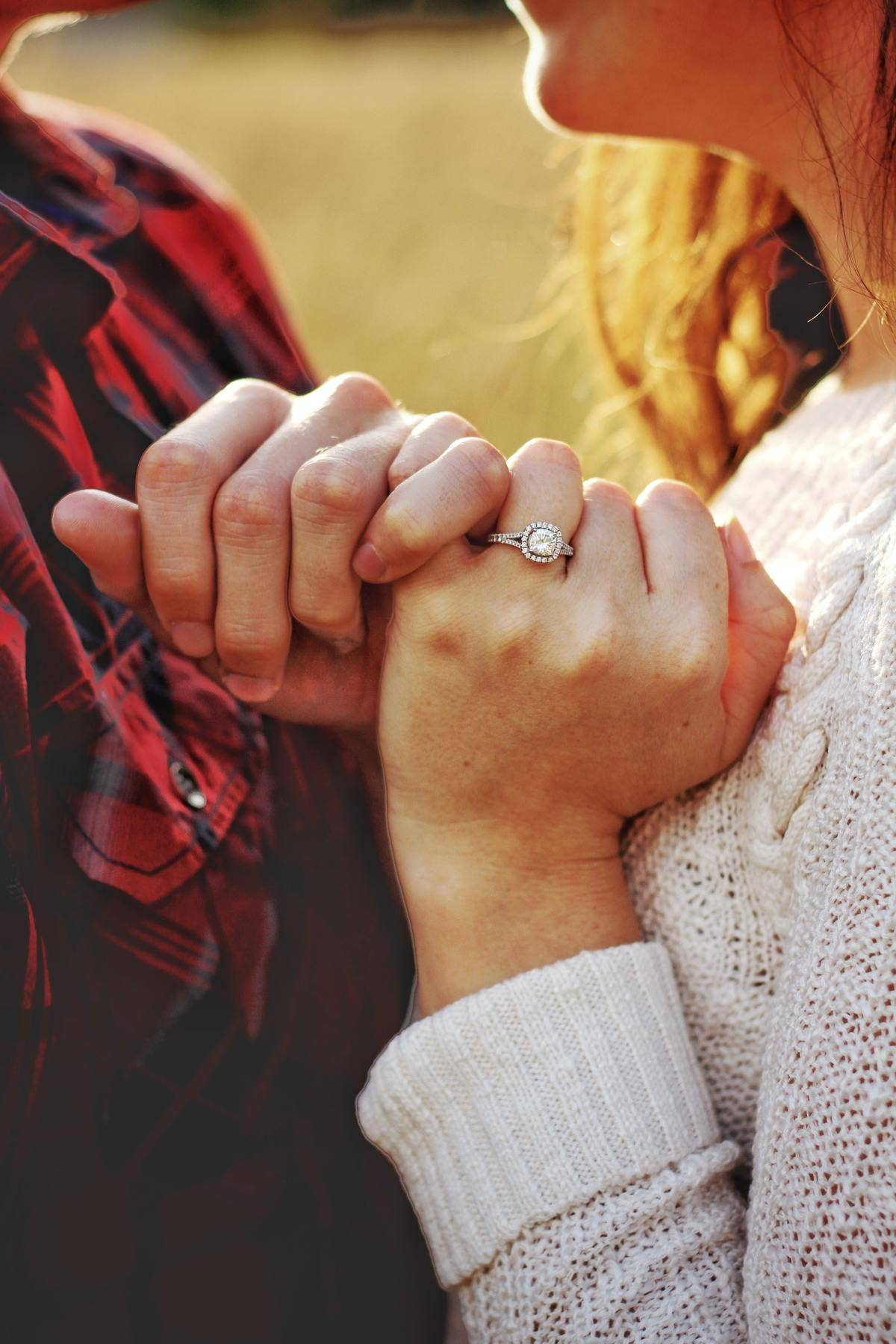 Pinky promise with engagement ring