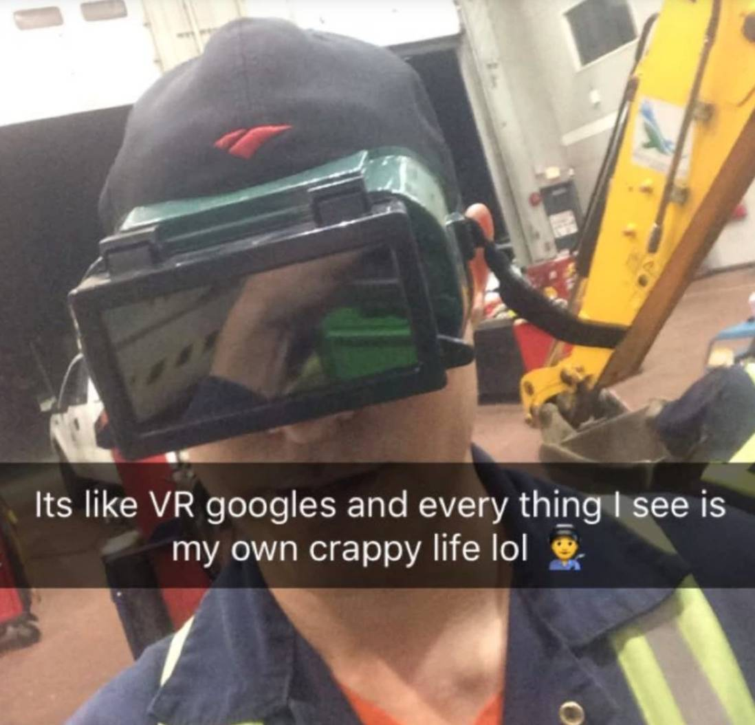 man in weird goggles with caption: It's like VR goggles and everything I see is my own crappy life