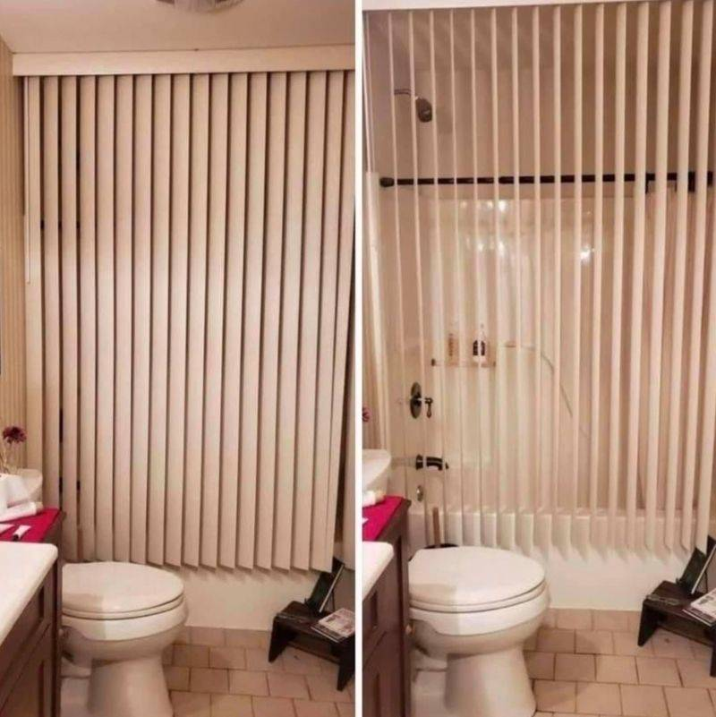 a bathroom with a shower that has blinds as the shower curtain