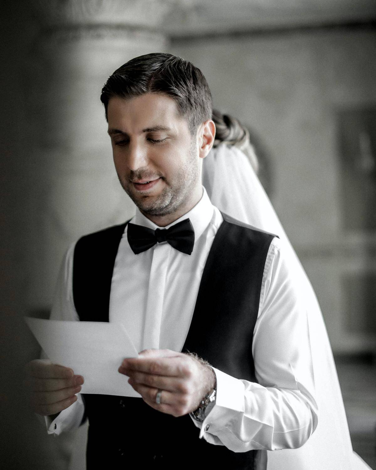 bride and groom back to back reading their vows