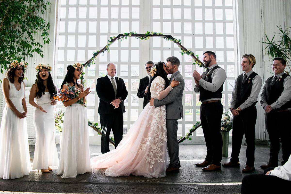 bridesmaid stands on balcony with wedding party