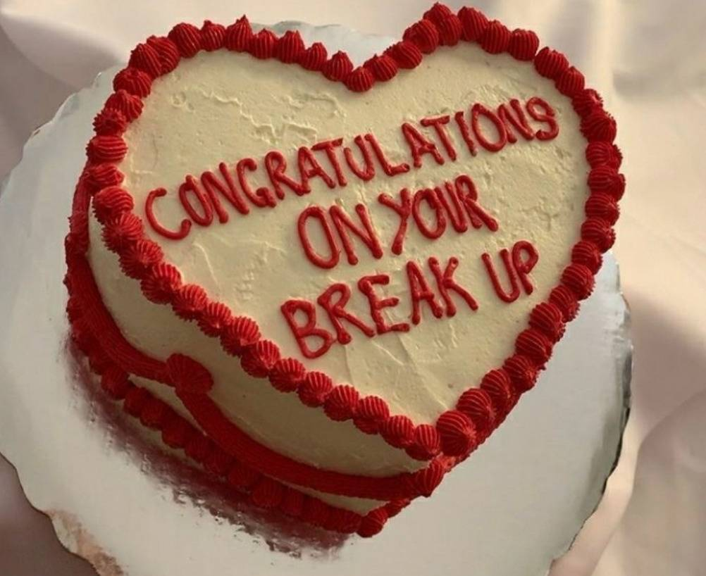 heart shaped cake with writing: congrats on your break up