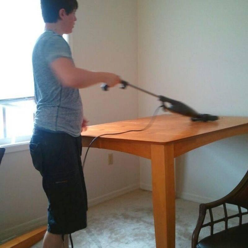 boyfriend vacuuming the table