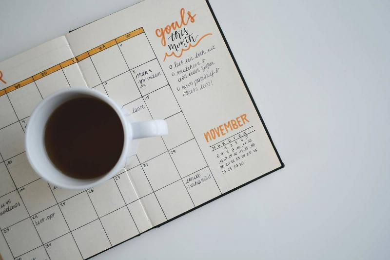 cup of coffee over agenda