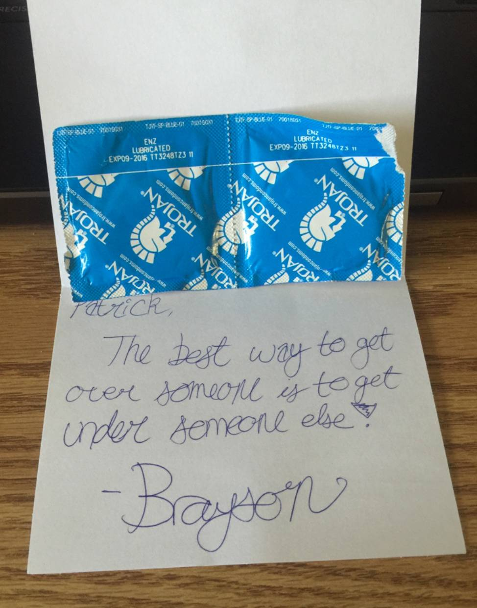 card with two condoms in it and inscription: