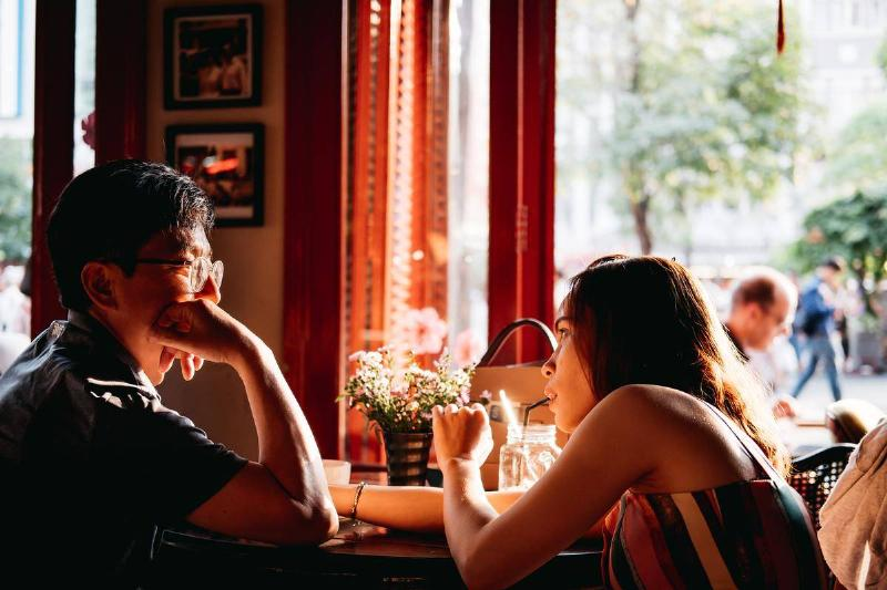 man and woman sizing each other up on lunch date