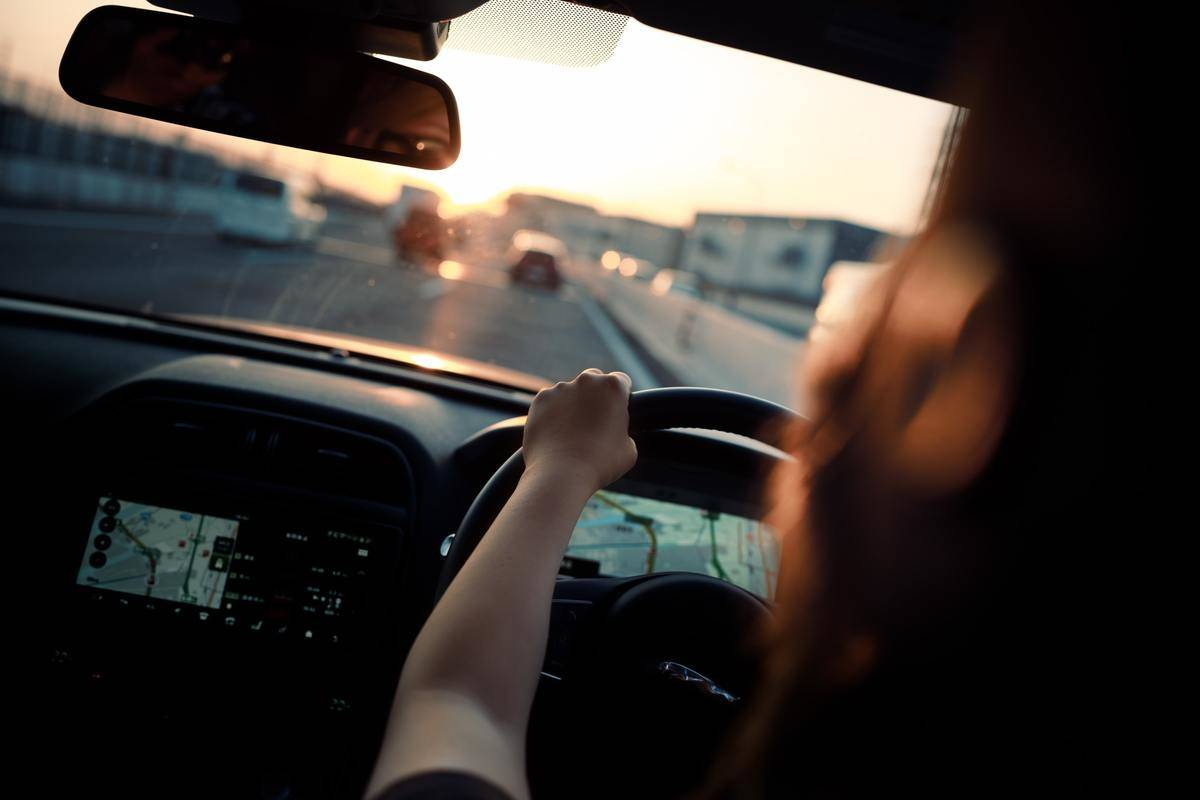 Woman driving on highway