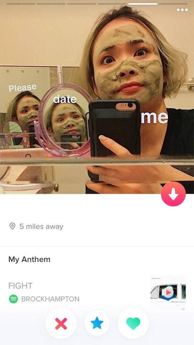 tinder profile picture that is a woman with a face mask on and her reflection with the words