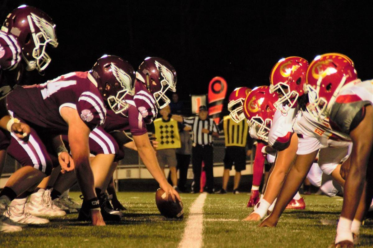 close up of football players at the line