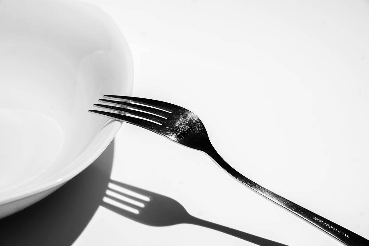 fork balancing on the edge of a plate