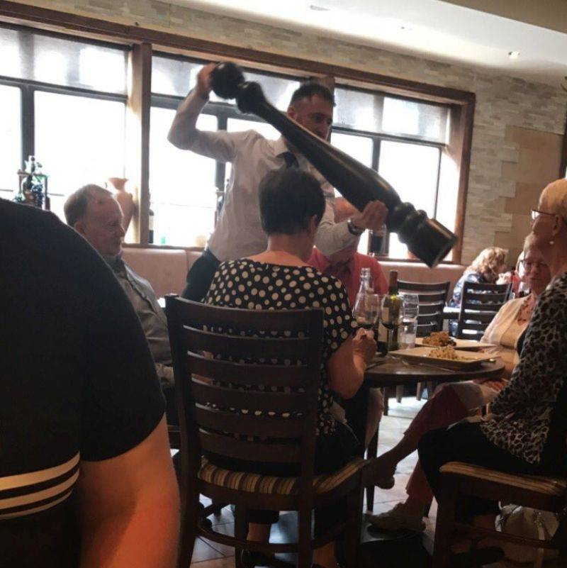 a restaurant has a giant pepper grinder