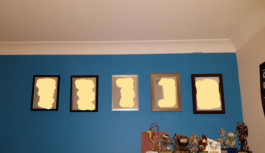 boyfriend hung his certificates on the wall without measuring them