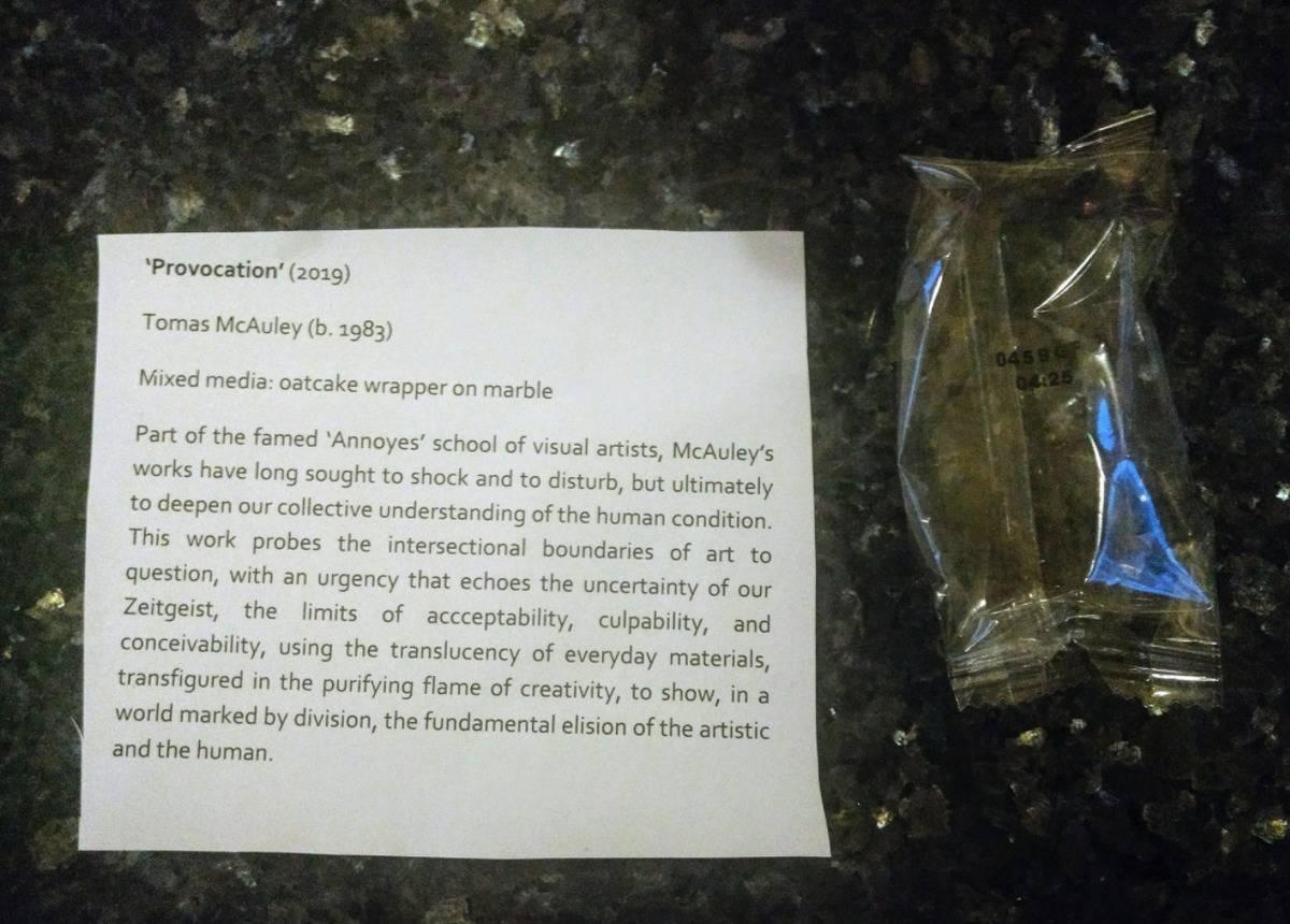 husband as a joke left an art exhibit write up next to an empty wrapper he left