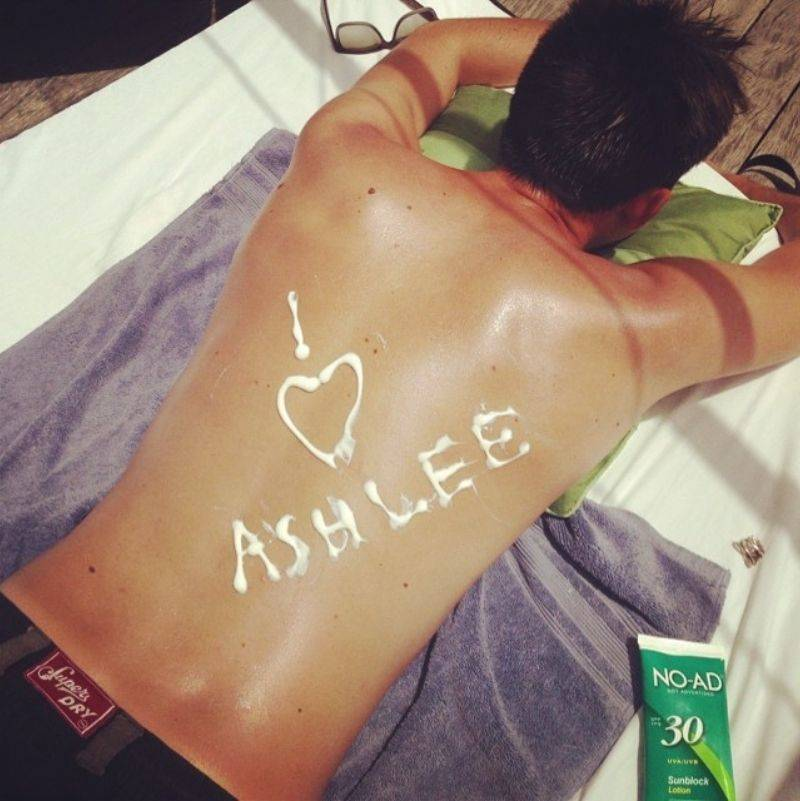 I heart Ashlee written in sunscreen on someone's back