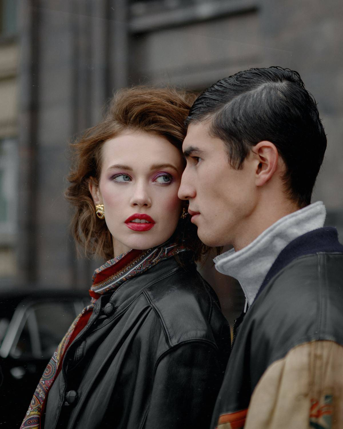 woman looking back at a man who is standing behind her