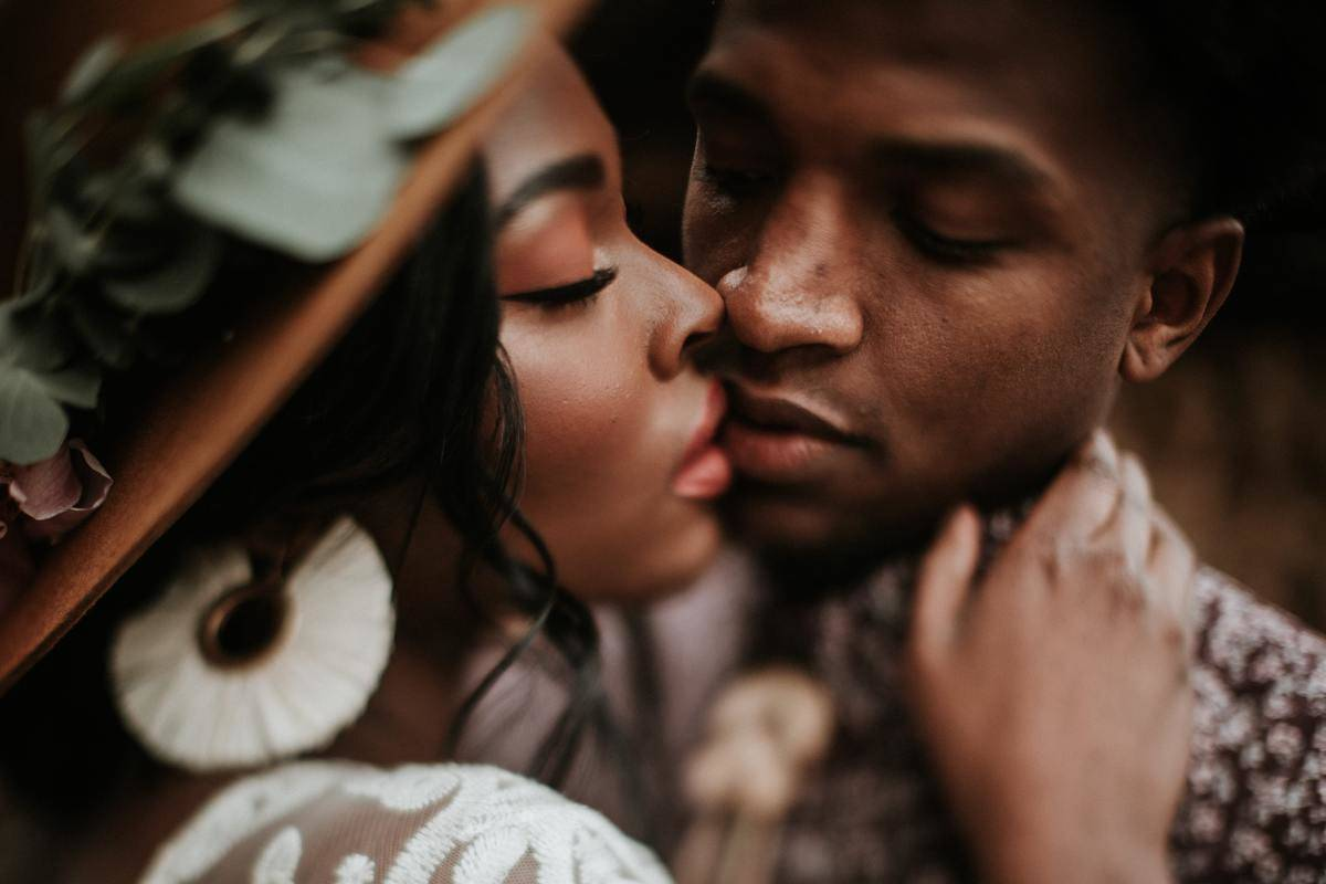man and woman almost kiss close up