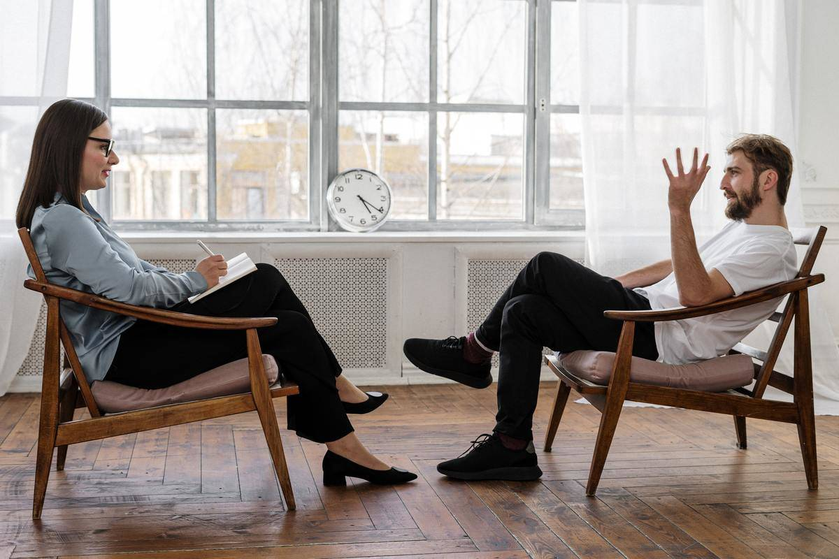 man and woman talk during therapy session