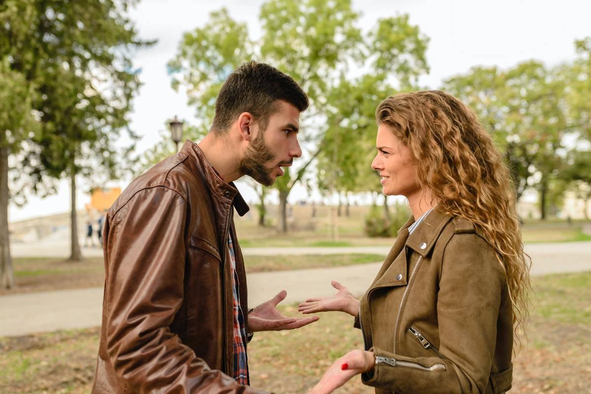 man and woman argue at park