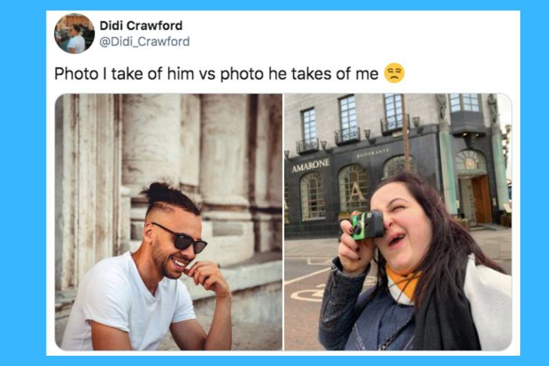 man smiling near pole while woman takes instant camera picture