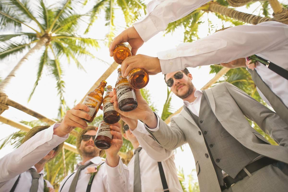 groomsmen each cheers their beer