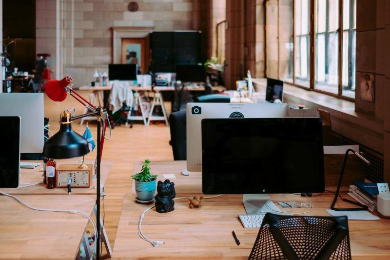 desks in open concept office