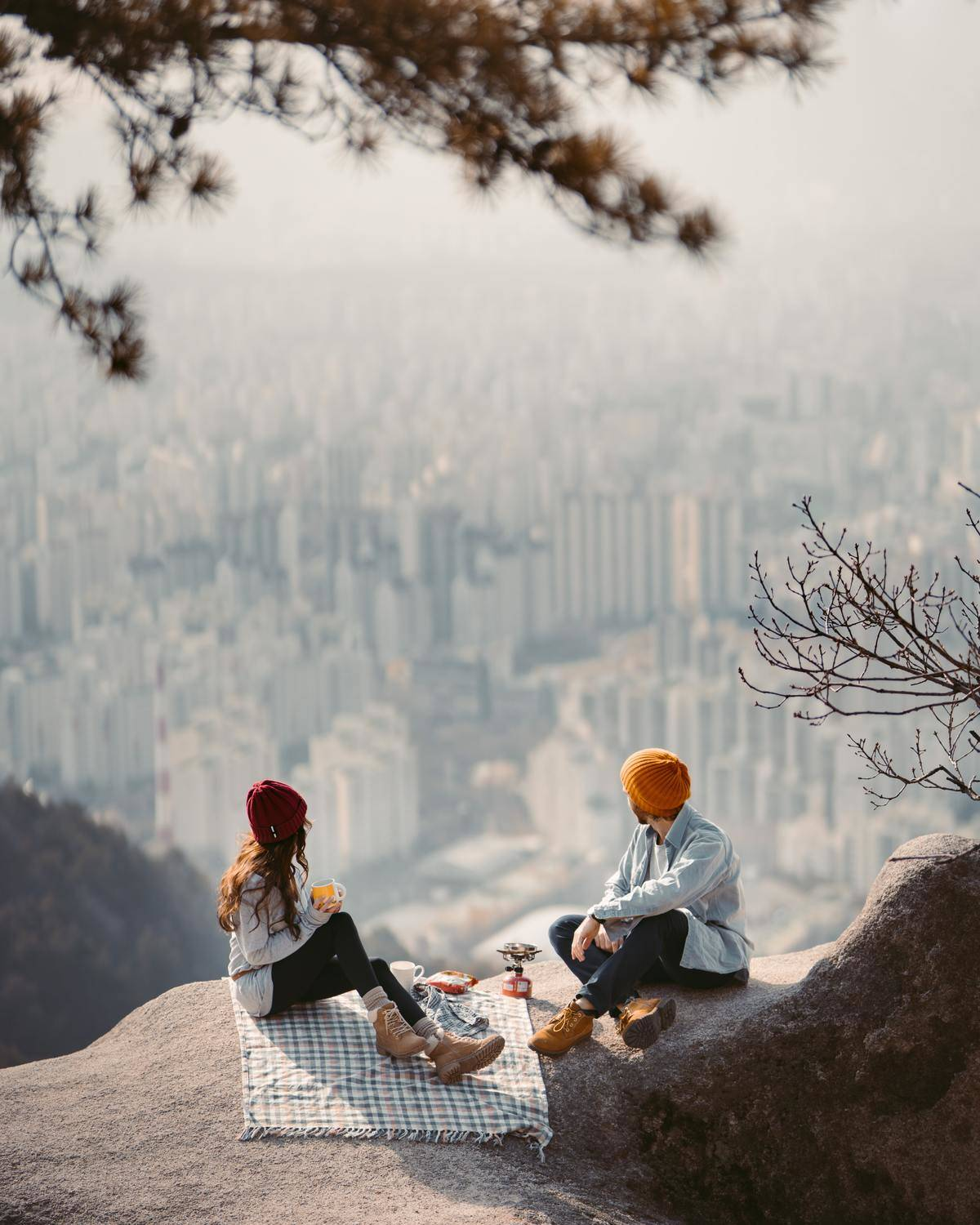 a couple on a picnic with a view of the city