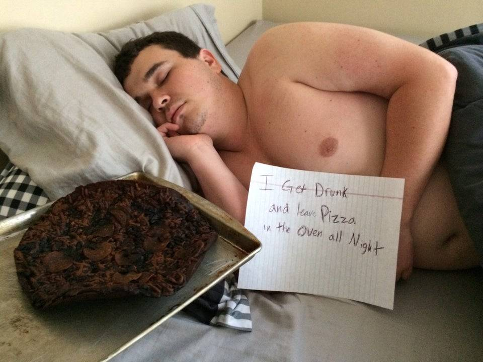 person sleeping with a note in front of them that says,