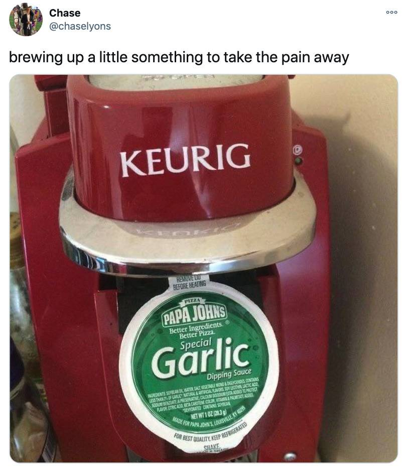 someone attempting to make a Garlic pizza dip a coffee drink in their Keurig