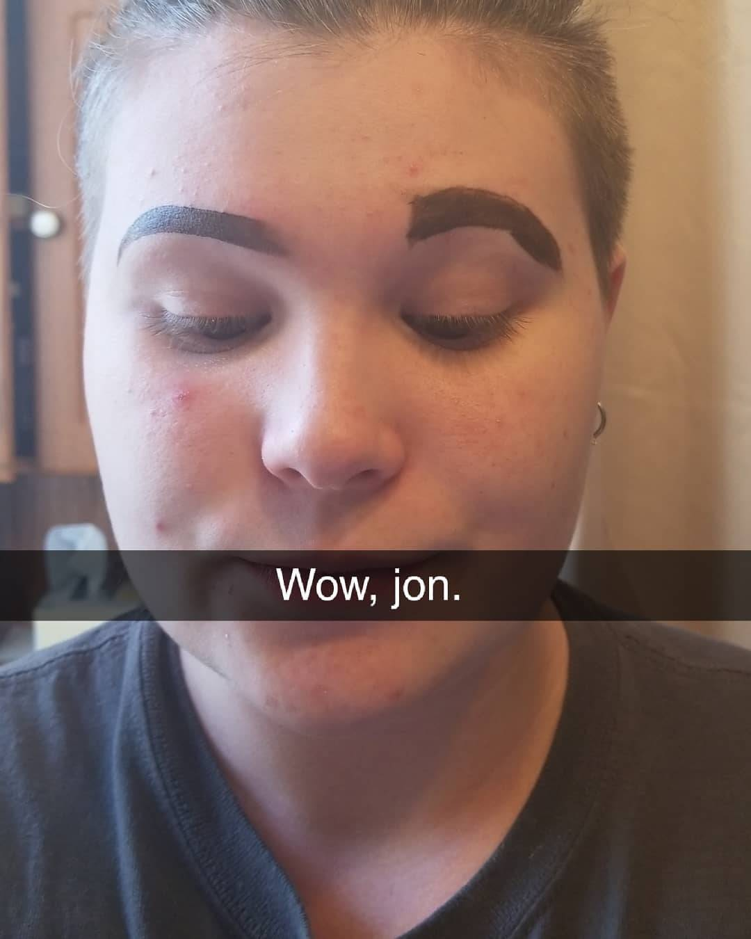 a woman with one perfectly done eyebrow and one that is terrible with the snapchat text