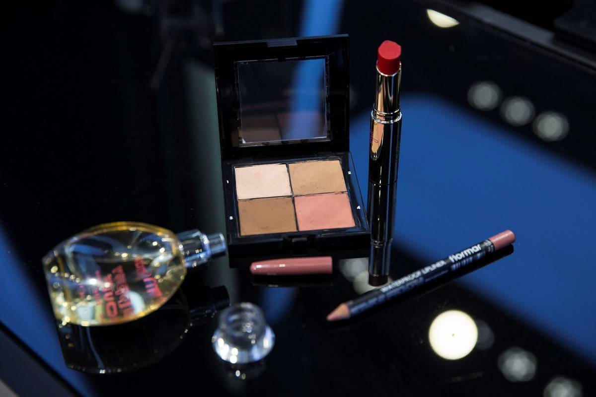 : A photo shows the close-up of a various types of eye shadows, perfume bottle, highlighter, lipstick and lip liner at a make-up and cosmetic products shop in Ankara,