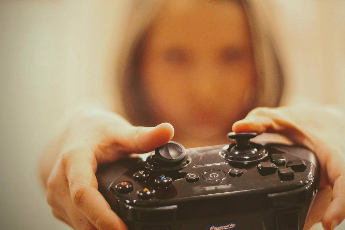 woman holding playstation controller