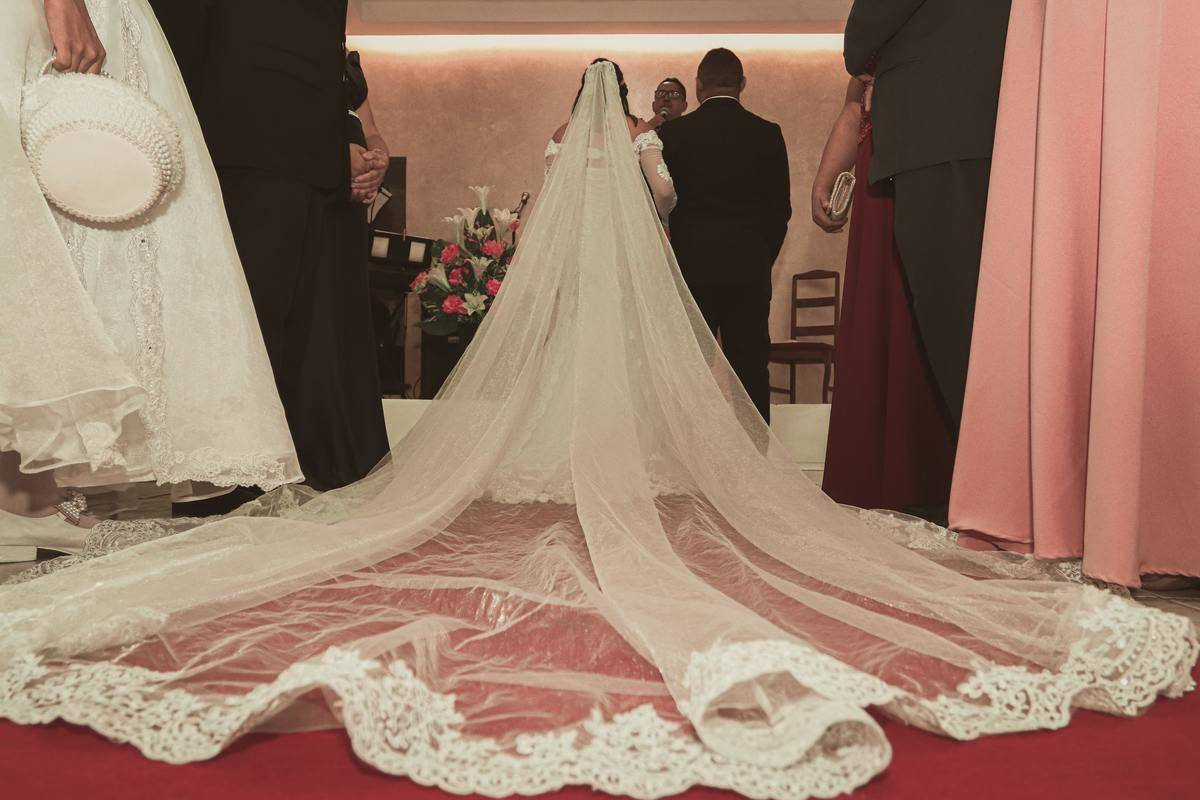 couple stands at wedding altar