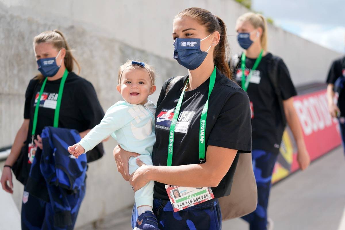 Alex Morgan #13 of the United States with her new baby girl arrives at the stadium before a game between Brazil and USWN