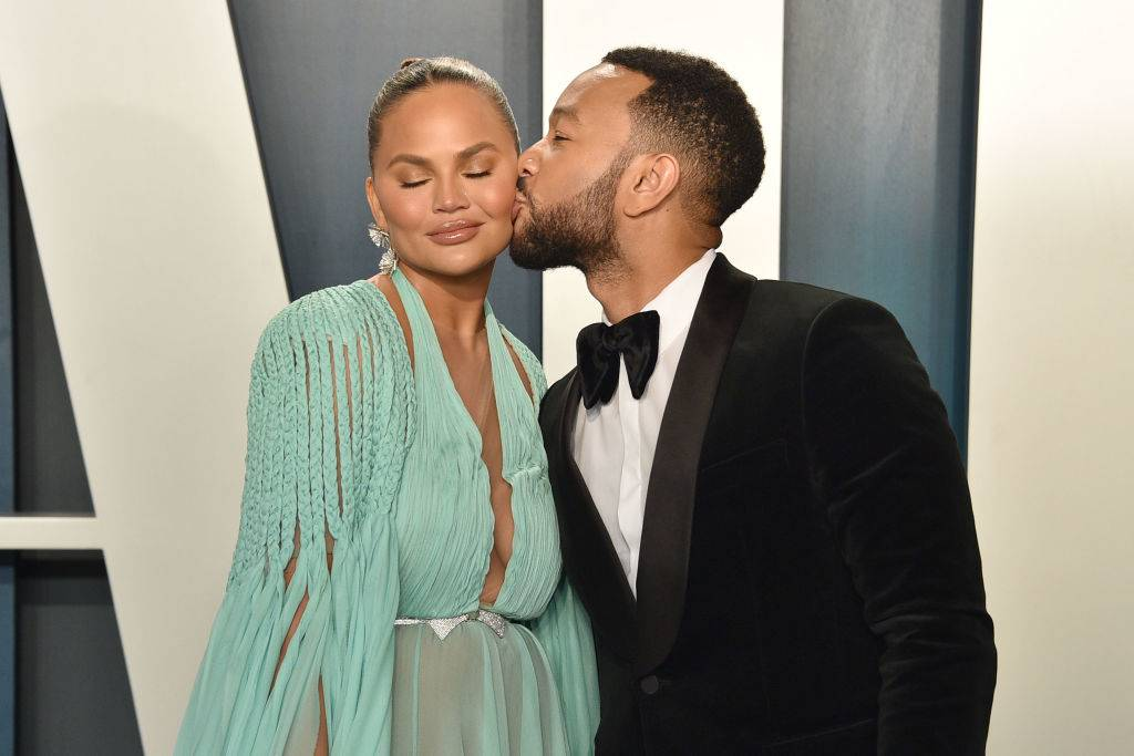 Chrissy Teigen and John Legend attend the 2020 Vanity Fair Oscar Party at Wallis Annenberg Center for the Performing Arts on February 09, 2020 in Beverly Hills, California.